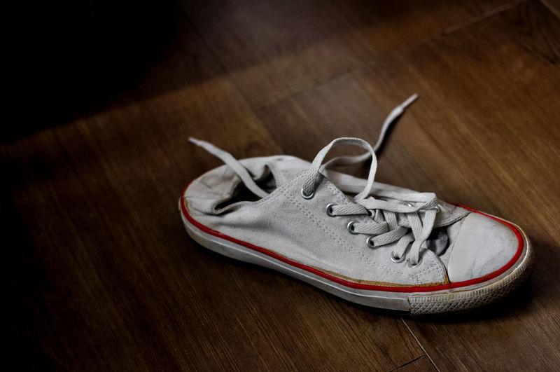 High angle view of canvas shoe on hardwood floor