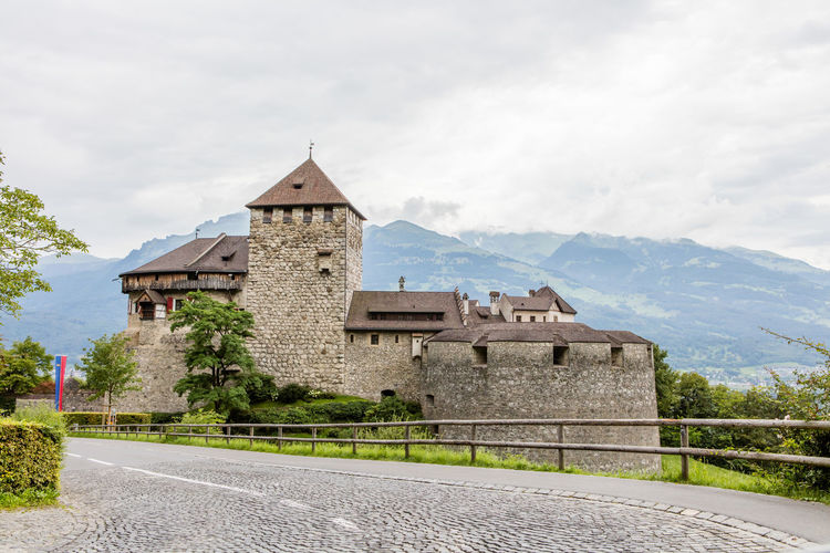Building Building Exterior Castle Clouds Day Fortress Liechtenstein Medieval Mountain Outdoors Road