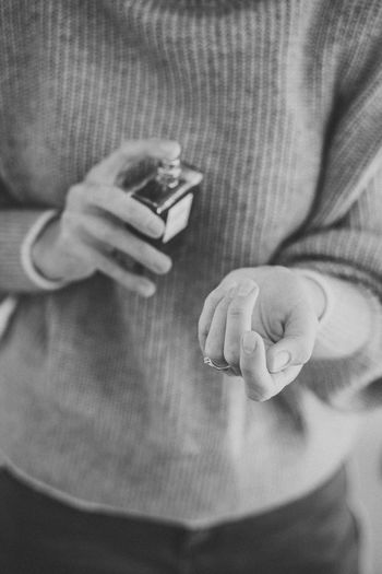 Close-up of man holding mobile phone