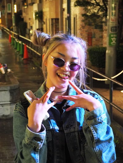 Asian Girl Cool Cool Gang Signs Leisure Activity Millennial One Person Outdoors Piercing Real People Tokyo Street Photography Tokyo Style Tongue Tongue Piercing Tounge Out  Yeah Young Adult The Portraitist - 2017 EyeEm Awards