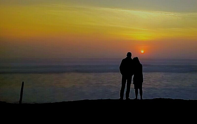 Sunset Lovers Sea And Sky Seascape Enjoying Life Orange Color Tenderness BIscarrosse Plage France End Of The Day Full Length Togetherness Sea Silhouette Friendship