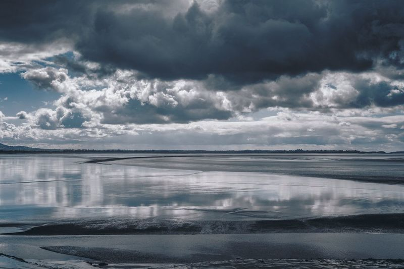 Severn estuary River Tidal Severn Estuary Cloud - Sky Water Sky Scenics - Nature Sea Beauty In Nature Nature Reflection No People Environment Tranquil Scene Tranquility Day Outdoors Dramatic Sky Land Horizon Landscape Power In Nature Ominous