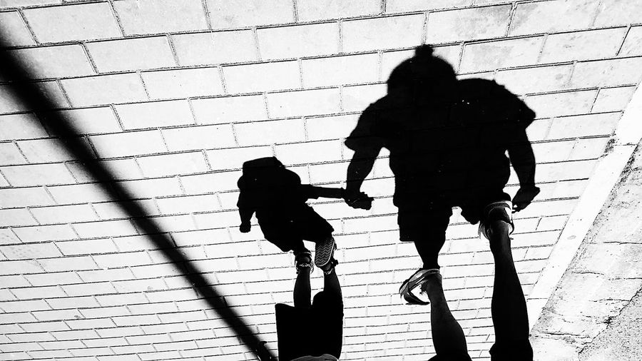 Blackandwhite Fatherandson Walking Walking Around Streetphotography Shadow Walking Focus On Shadow Real People Full Length Bonding Childhood Men People Outdoors Sunlight Togetherness Day Father And Son Welcome To Black Mix Yourself A Good Time Black And White Friday This Is Family Visual Creativity