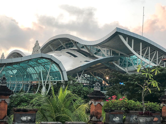 Bali airport Architecture Built Structure Sky Plant Building Exterior Nature Cloud - Sky Tree Outdoors Travel Destinations Day Incidental People Greenhouse City Growth Connection Travel Arts Culture And Entertainment Building Bali Airport]] Airport Beauty In Nature INDONESIA