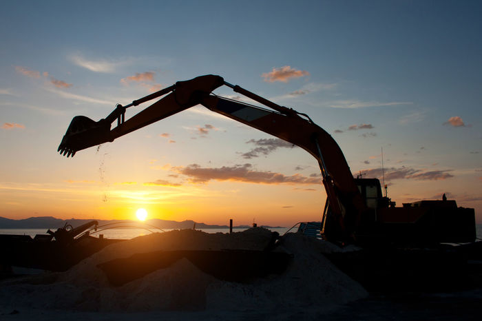 Architecture Bulldozer Cloud - Sky Construction Industry Construction Machinery Crane - Construction Machinery Earth Mover Industry Machinery Mode Of Transportation Nature No People Orange Color Outdoors Silhouette Sky Sun Sunlight Sunset Transportation