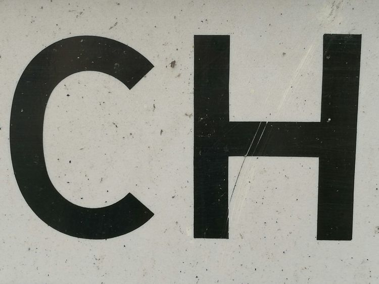 Communication Western Script Close-up Part Of Street Sign CH No People Outdoors Symbol Letters Typography Version