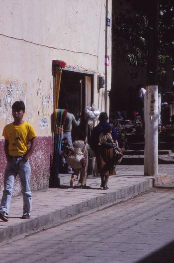 1988 Leisure Activity Lifestyles Men Mexico Occupation Real People Road San Cristóbal De Las Casas, Chiapas. Street Walking Women Yellow T Shirt