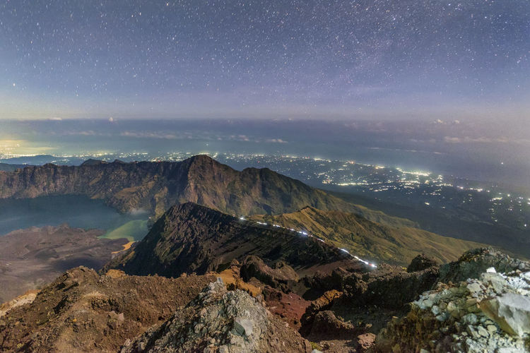 Blue Hour at Summit Mount Rinjani Beauty In Nature Distant Dramatic Landscape Geology Majestic Mountain Mountain Range Nature No People Non-urban Scene Outdoors Physical Geography Rock Formation Scenics Sea Seascape Sky Star Field Tourism Tranquil Scene Tranquility Travel Destinations Water