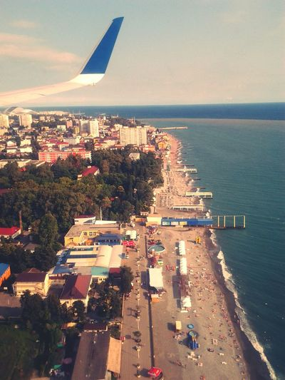 Aerial View Of City Waterfront And Beach