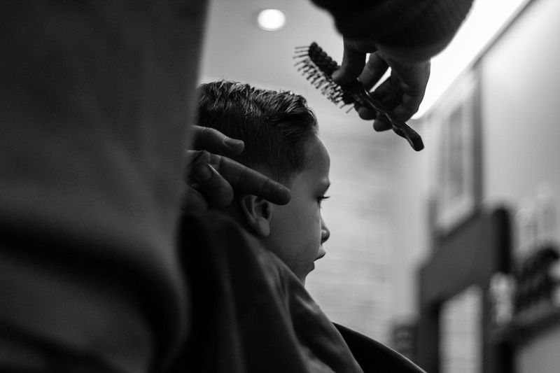 Close-up of child in barber shop