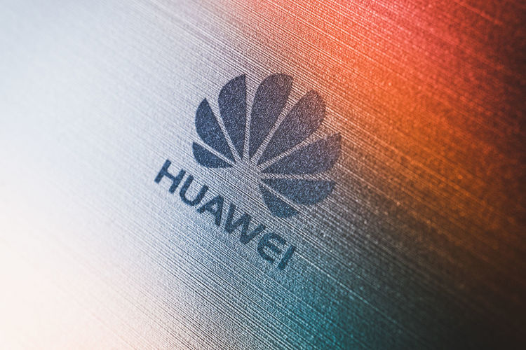 PHUKET, THAILAND - MAY 21, 2019: macro shot of Huawei logo, Google blocks Huawei's access to Android updates on may 20 and US delays Huawei ban for 90 days afterward Huawei Us Access Android Ban Block China Color Company Delay Device Editorial  Focus Gadget Golden Google Icon Illustrative Logo Metal Mobile Network Phone Prohibition Selective Smartphone Supply Surface Technology Telecommunication Update