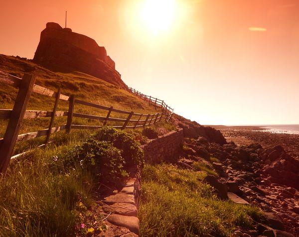 Built Structure Castle Coast Fence Holy Island Landscapes With WhiteWall Lindisfarne Northumberland Pebble Beach Sky Sun Sunlight Sunrise Sunrise_sunsets_aroundworld Tranquil Scene Tranquility Things I Like
