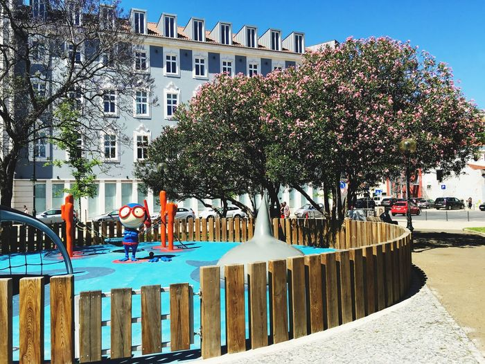 Playground magic. Playground Comic Cartoon Building Exterior Tree Blossoms  Architecture City Life Outdoors Park Square No People Blue Sky Silly Face Travel Destinations Lisboa Iphone6s Shark Attack