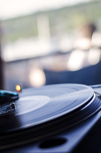 Vinyl record playing on turntable. Arts Culture And Entertainment Bokeh Day Daylight Dj Good Vibes Indoors  Lifestyle Lifestyles Music No People Old School Play Playing Music Record Record Player Record Player Needle Technology Turntable Vinyl EyeEmNewHere The Week On EyeEm