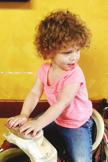 Little Miss Cutie Child Childhood One Person Females Curly Hair Girls Real People Looking Away Innocence Cute Looking Sitting Leisure Activity Indoors  Hairstyle Casual Clothing