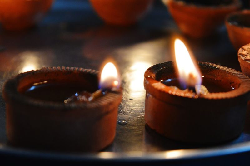 Flame Burning Heat - Temperature Candle Indoors  No People Night Diya - Oil Lamp Illuminated Close-up The Great Outdoors - 2017 EyeEm Awards The Photojournalist - 2017 EyeEm Awards Photography The Week On EyeEm EyeEmNewHere EyeEm Selects Bloggers Blogphotography
