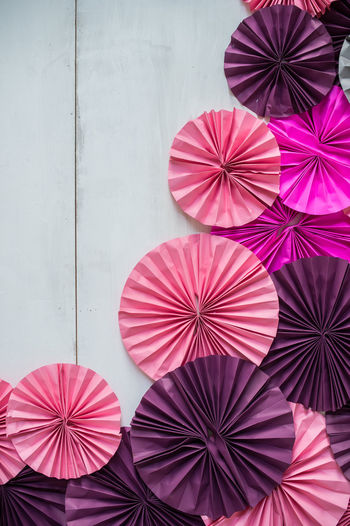 Low angle view of multi colored umbrellas on wall