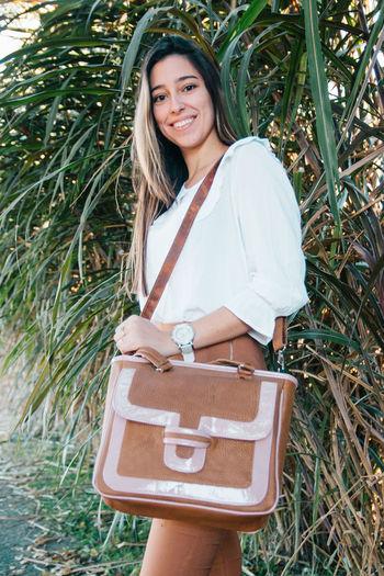 Elegant woman wearing leather bag