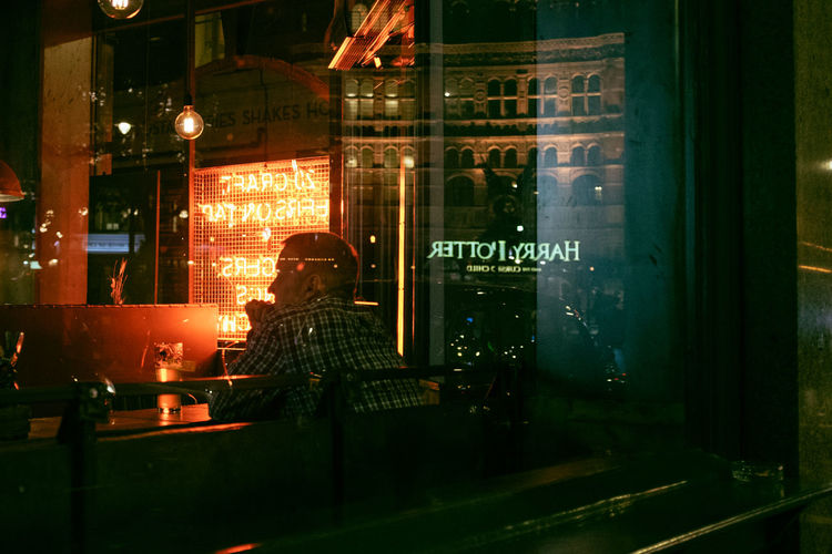 Reflection of man in glass window