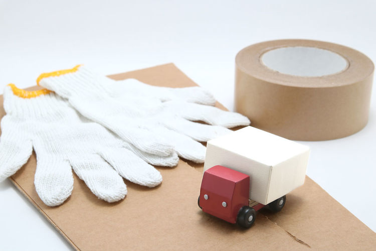Copy Space Delivery Logistics Lorry Moving Transportation Box Car Cardboard Cargo Carry Changing Residence Demis Freight Transportation Indoors  Mail Order Miniature No People Still Life Studio Shot Toy Transfer Truck Vehicle White Background