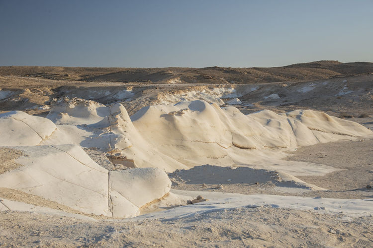 Beautiful lunar landscape. wight and smooth hills. the whitish, smooth chalk rocks. israel.