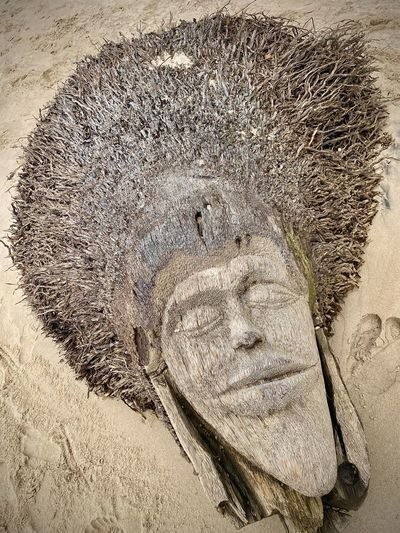 High angle view of sculpture on sand