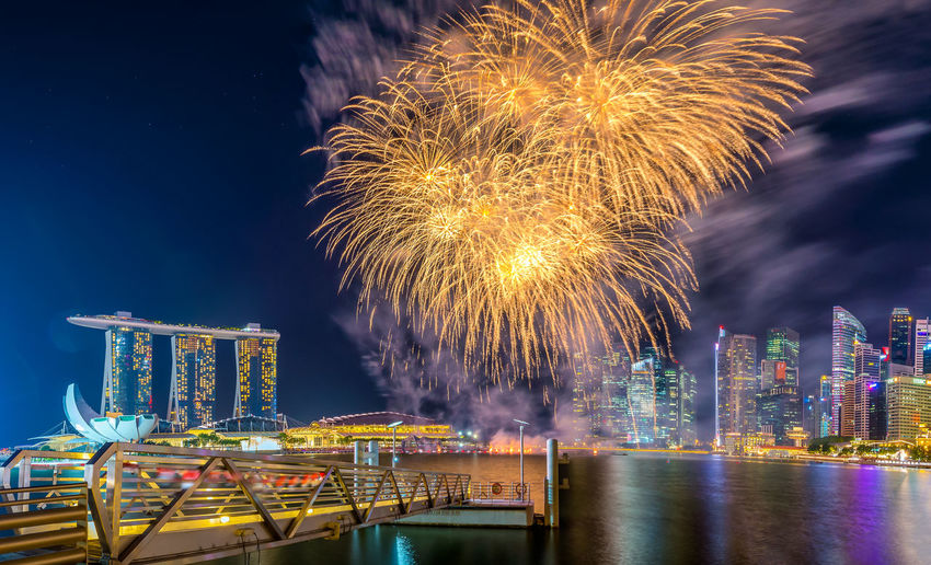 Marina Bay Sands Architecture Art Science Museum Building Exterior Built Structure Celebration City Cityscape Firework - Man Made Object Firework Display Illuminated Long Exposure Marina Bay Ndp2017 Night No People Outdoors Sg52 Sky Skyscraper Urban Skyline Water Waterfront