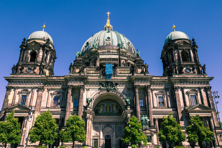 Exterior view of Berliner Dom, also known as Berlin Cathedral in the historic city of Berlin in Germany on a sunny summer day Building Exterior Architecture Dome Built Structure Sky Travel Destinations Tourism The Past Travel Building History Nature Low Angle View Clear Sky Religion City Place Of Worship No People Arch Outdoors Architectural Column Government Dom Berlin Cathedral Berlin Cathedral My Best Photo