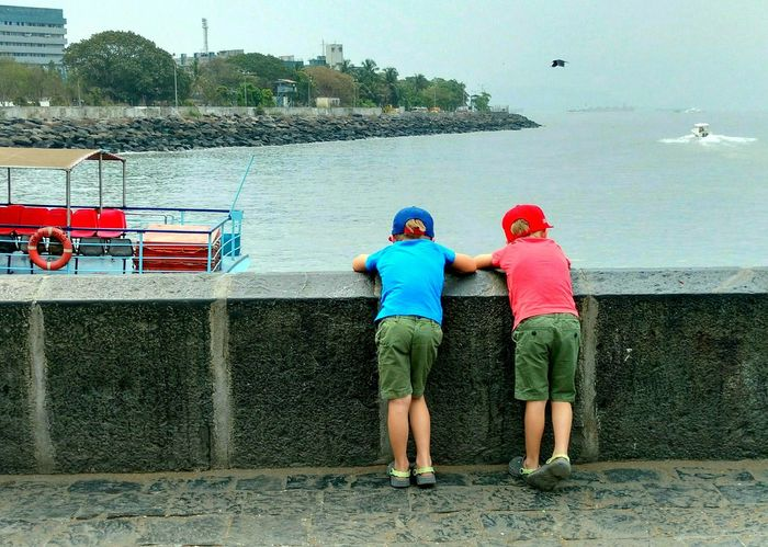 Two People Water Rear View Real People Outdoors People Day Togetherness Standing Nautical Vessel Young Adult Sky Photography Phonephotograpy Mobilephotography Motoxplay Motoxplayclick Motoxplayphotography Sea Seascape Sea And Sky Brothers Youngwildandfree Kids Kidsphotography Boat