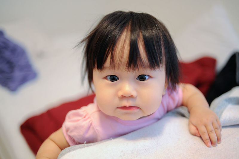 Asian Baby  Asian Girl Baby Babyhood Bed Bedroom Childhood Close-up Cute Day Headshot Indoors  Innocence Looking At Camera One Person People Portrait Real People