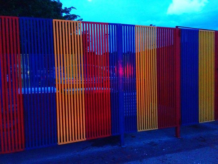 Multi colored built structure against blue sky