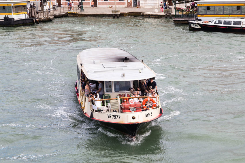 Venice water taxi... Tourist Venice Canals Venice Italy Venice Taxi Venice Water Taxi Venice, Italy Architecture Boat Boats Building Exterior Built Structure Day Italy Mode Of Transport Nature Nautical Vessel Outdoors Real People Sea Tourism Transportation Venice Venice View Water Waterfront
