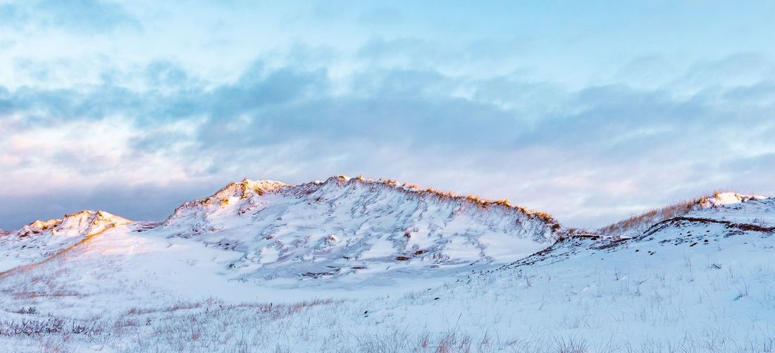 Beauty In Nature Sky Cloud - Sky Mountain Winter Snow Cold Temperature Tranquil Scene No People Nature Tranquility Mountain Range Environment Non-urban Scene Landscape Outdoors Scenics - Nature Snowcapped Mountain Remote Mountain Peak