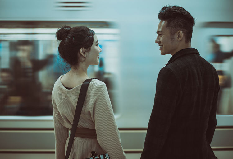 Couple standing on subway station