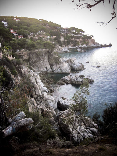 Rocks at Dawn, Lloret de Mar is a Mediterranean coastal town in Catalonia, Spain. One of the most popular holiday resorts on the Costa Brava Lloret De Mar Beauty In Nature Catalonia Cliff Mediterranean  Mediterranean Seascape Mountain Nature Non-urban Scene Outdoors Remote Rock - Object Rock Formation Rocks And Water Rocky Scenics Sea Sky SPAIN Tranquil Scene Tranquility Travel Travel Destinations Vivid International Water