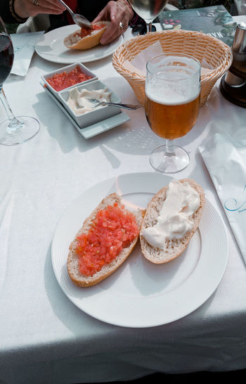 dinning outside in Spain Spanish Food SPAIN Beer Beer - Alcohol Starters Spread Sause Bread White Tablecloth Table Eating Food Missing Bite Started Drink Alcohol Drinking Glass Plate Table Wineglass Coffee - Drink Close-up Sweet Food Food And Drink Frothy Drink Saucer Beverage Beer Glass Spreading