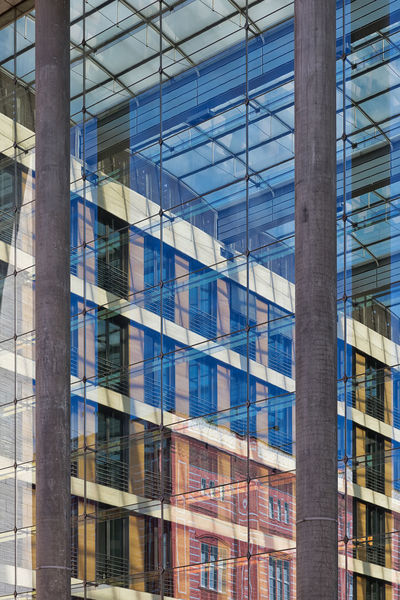 Disappearing glass lines of an office building. Vertical glass facade with blue tinted large windows Architectural Detail Architecture Architecture_collection Architecturelovers Blue Design Edgy Glass Glass - Material Infinity Pattern Reflection Reflections Shape Shapes Sharp
