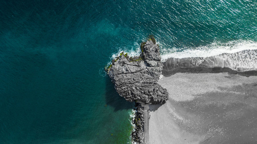 Drone view of a rock separating the sea from a beach Madeira Island Portugal Aerial View Basalt Beach Beauty In Nature Drone Photography Dronephotography Droneshot High Angle View Nature No People Ocean Outdoors Scenics - Nature Sea Top View Travel Turquoise Colored Water