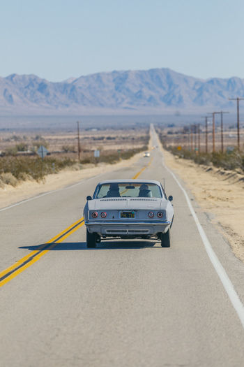 Arid Climate Car Clear Sky Day Desert Driving Land Vehicle Landscape Mode Of Transport Mountain Nature No People Outdoors Road Road Trip Sky Speed The Way Forward Transportation Neighborhood Map Neighborhood Map
