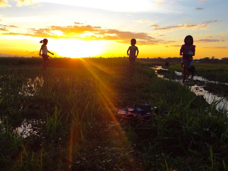 Childs Play Child Playing Childhood Friendship Grass Leisure Activity Outcast Outdoors Philippines Shadows & Lights Sky Sunlight Sunset Togetherness