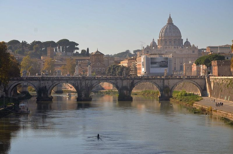 Ponte sant angelo over tiber river against st peter basilica