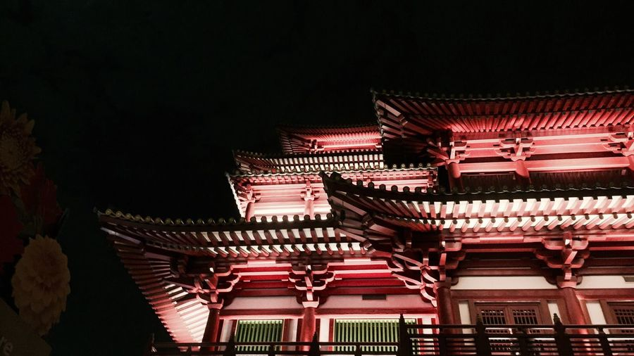 Low angle view of illuminated chinese temple at night