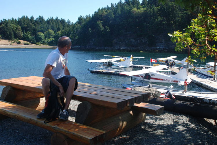 Sea Plane Adult Adults Only Day Full Length Lake Leisure Activity Men Nature Nautical Vessel One Man Only One Person Outdoors People Real People Sea Taxi Sitting Tree Vancouver Island BC Water Wood - Material