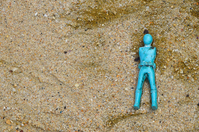 Lost blue toy soldier body without arms in the surf of sand sea beach Abandoned Back Beach Blue Broken Childhood Close-up Figure Figurine  Forgotten Found Game Ground Lost Nature Outdoors Pivotal Ideas Sand Shore Story Surf Toy Toy Soldier Toy Soldiers