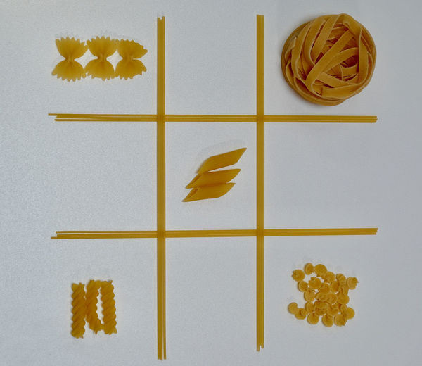 High Angle View Of Pasta Arranged On Table