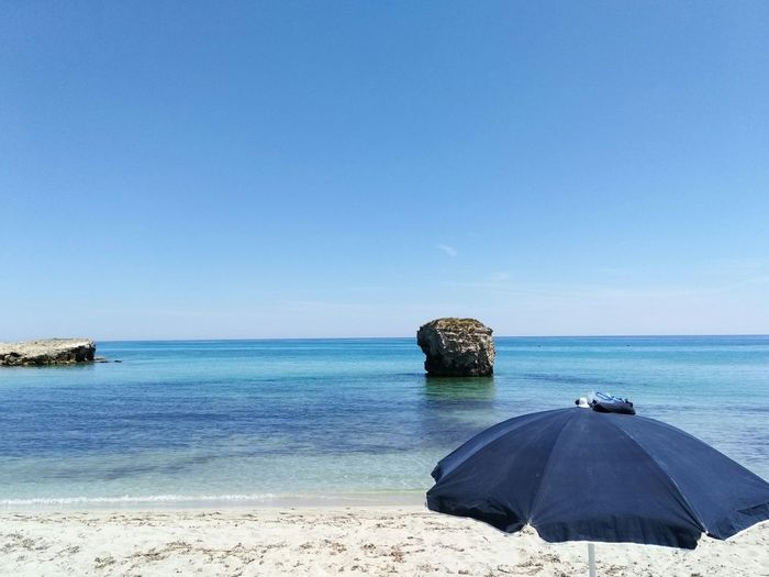 Beach Sea Relaxation Blue Tranquility Summer Nature Sand Clear Sky Beauty In Nature No People Scenics Water Day Outdoors Horizon Over Water Sky Umbrella Salento Puglia Lecce Wave Melendugno Sea Life Clear Sky Vacations