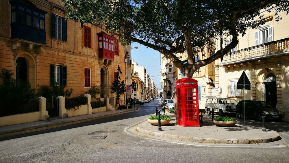 Building Exterior Built Structure Architecture Street Red City Outdoors No People Tree Road Sky Day Telephone Box Malta Sliema Malta Sun First Eyeem Photo Sqaure Plaza Place