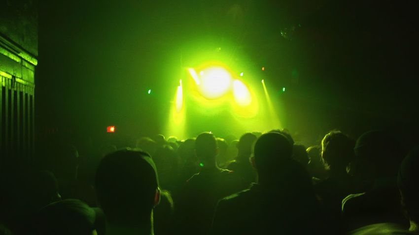 Arts Culture And Entertainment Music Nightlife Performance Stage - Performance Space Spotlight Stage Light Audience Green Color Enjoyment Men Indoors  Popular Music Concert Performing Arts Event People Night Crowd Adult Togetherness Adults Only