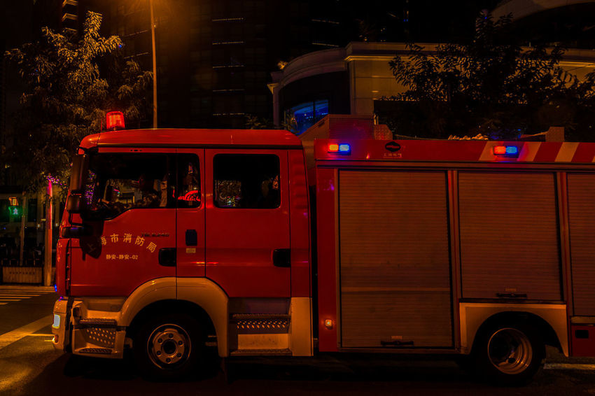 Night Fire Engine Land Vehicle Mode Of Transportation City Accidents And Disasters Architecture Illuminated Transportation Tree Street Red Building Exterior Healthcare And Medicine Plant Rescue Truck No People Outdoors Built Structure