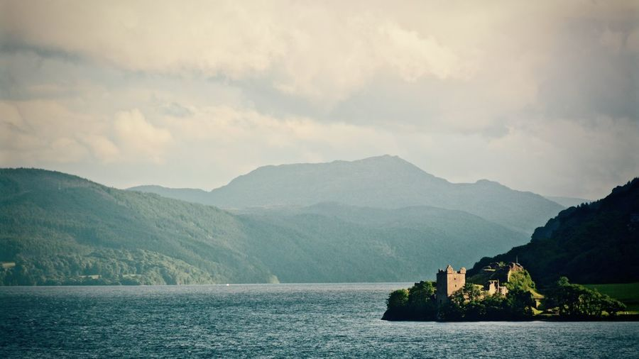Scenic View Of Urquhart Castle And Loch Ness With Mountains Against Sky